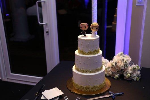Lauren and Tim's wedding cake with a Zelda cutting sword.