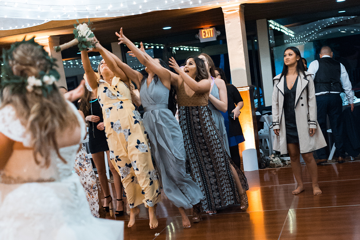 Taylor and Brian's Wedding Saticoy Country club bouquet toss 2018