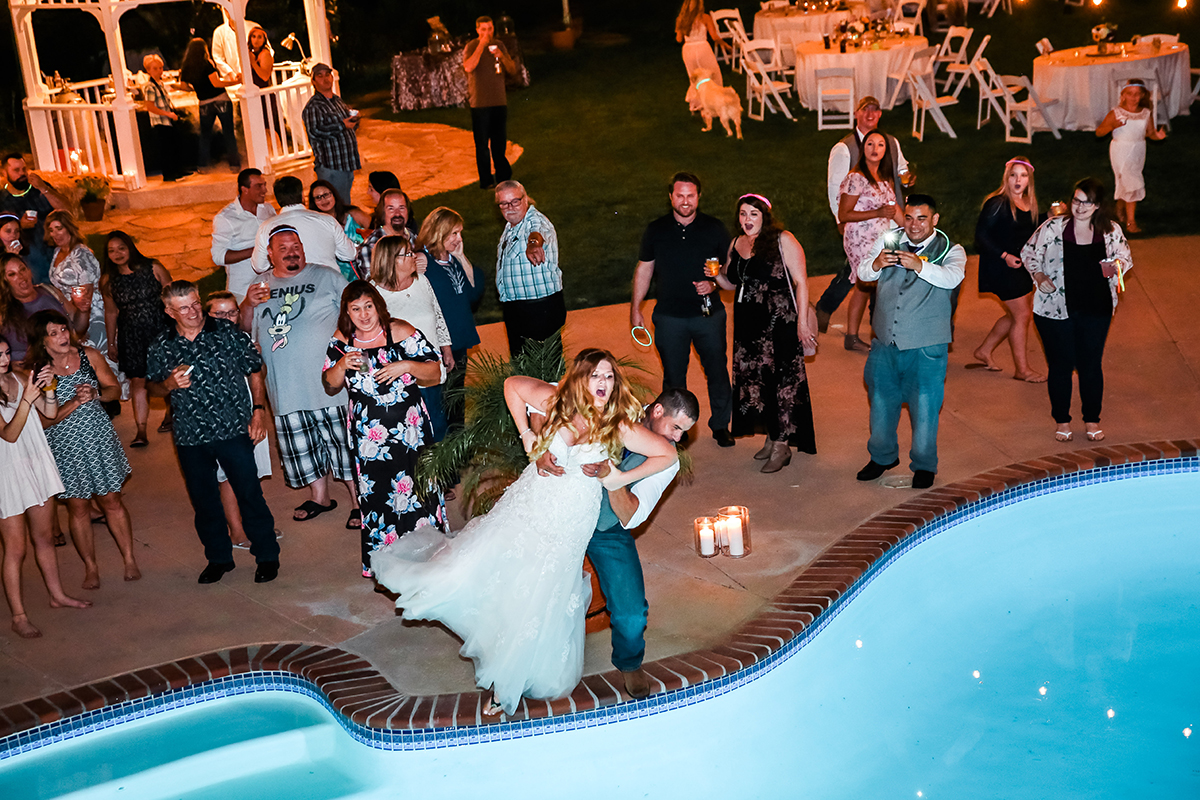 Jamie and Donnie jumping in pool wedding